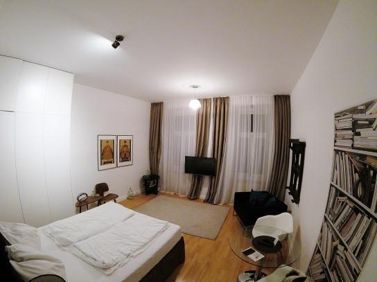 Dormitorio y sala de estar del Apartamento